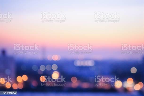 Photo of Blurred city sunrise background