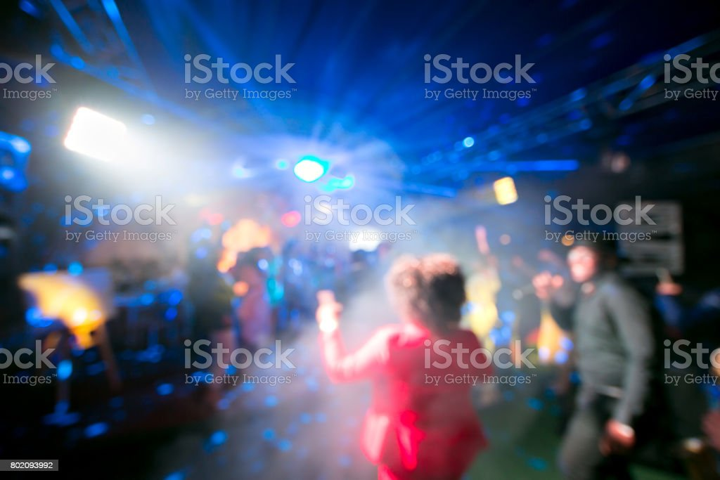 Blurred colorful lights inside music club stock photo