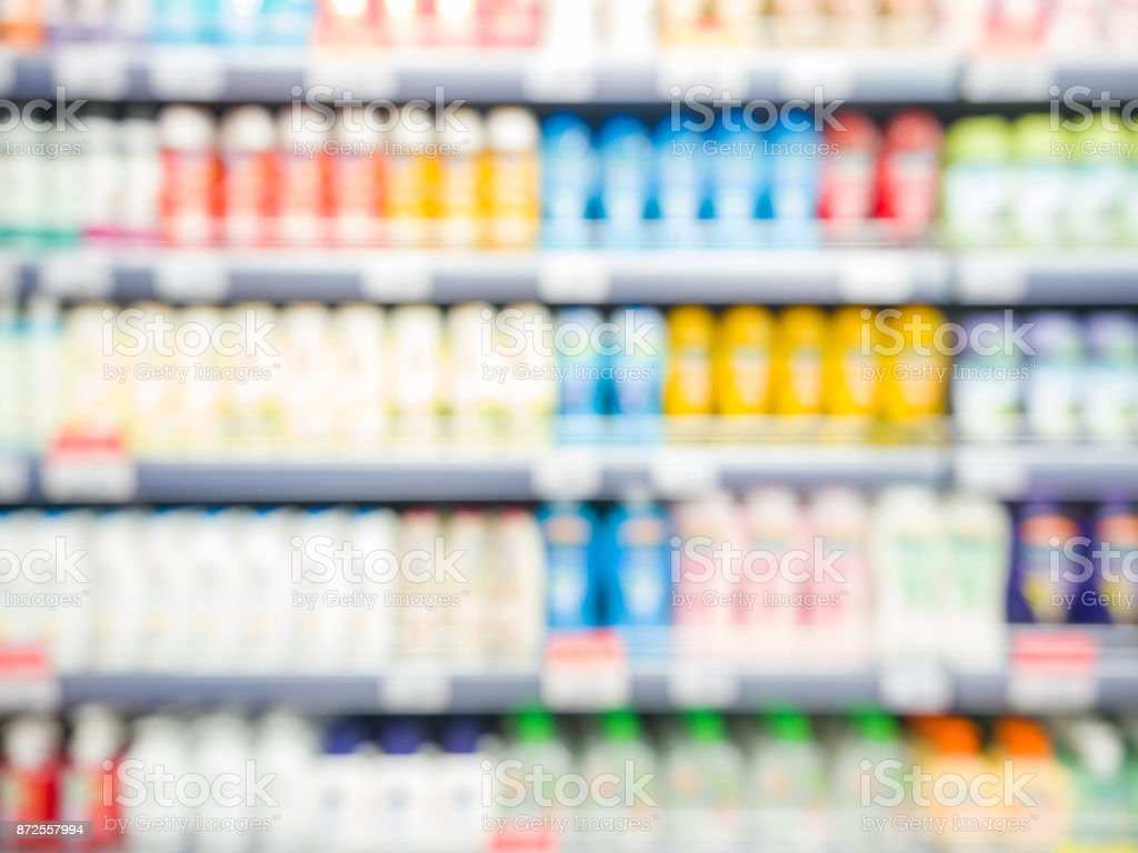 Blurred colorful supermarket products on shelves stock photo