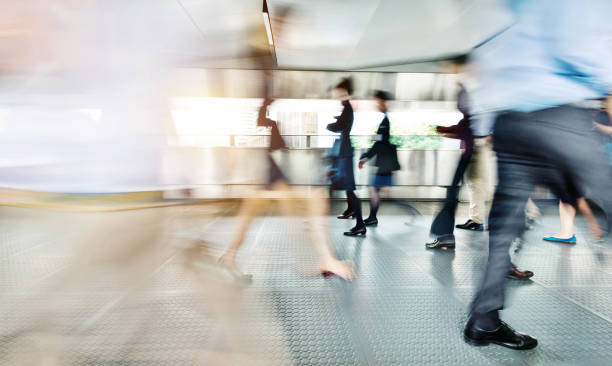 Blurred commuters walking on footbridge Blurred commuters walking on footbridge. footbridge stock pictures, royalty-free photos & images