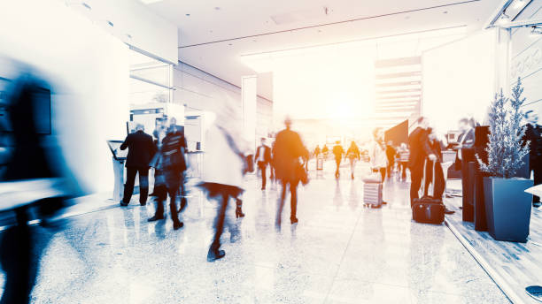 blurred crowd of people in a futuristic environment stock photo