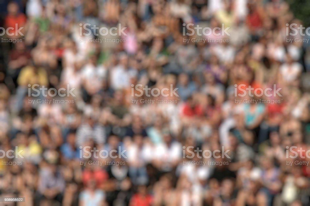 Blurred crowd of spectators stock photo