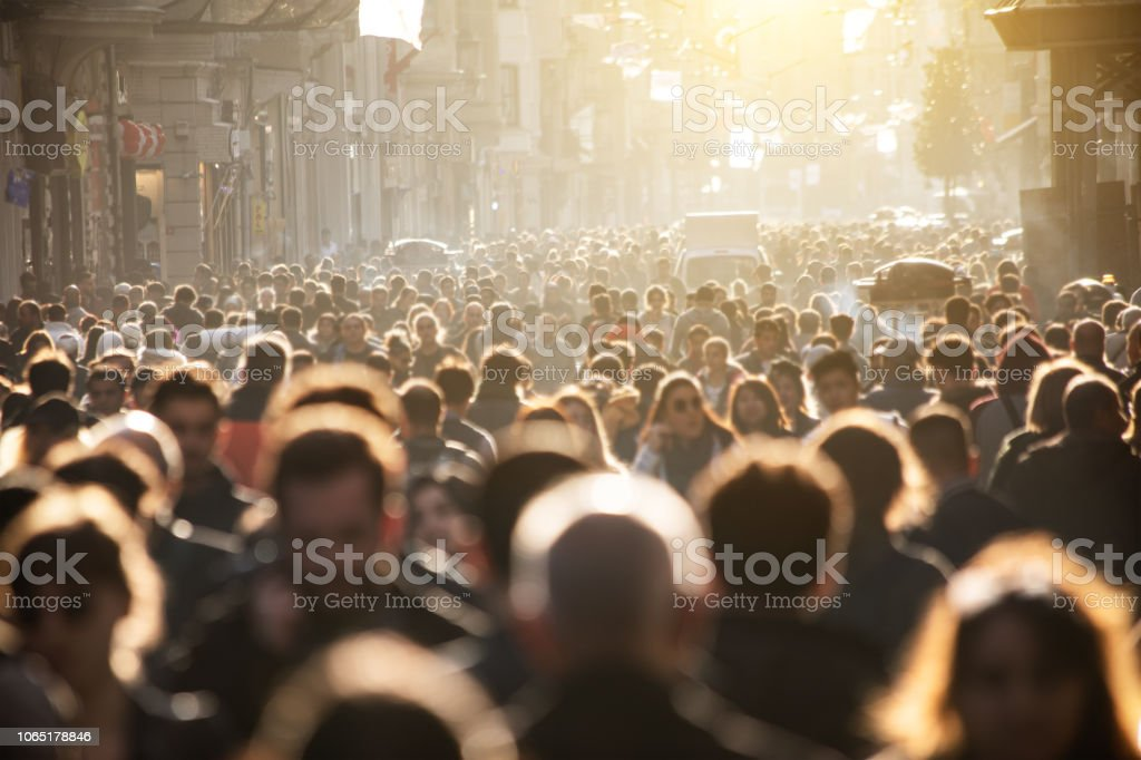 Blurred crowd of unrecognizable at the street stock photo