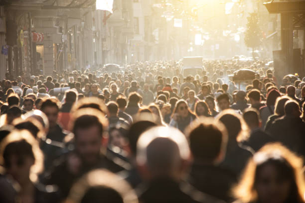 blurred crowd of unrecognizable at the street - busy stock photos and pictures