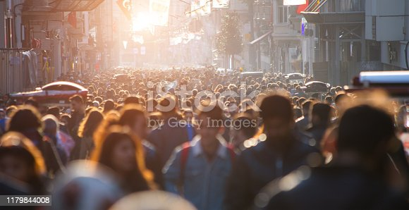 istock Blurred crowd of unrecognizable at the street 1179844008
