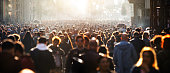 istock Blurred crowd of unrecognizable at the street 1207970825