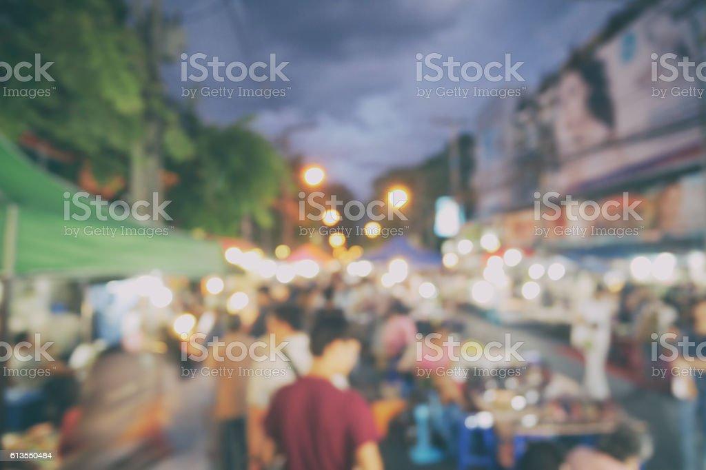 Blurred crowded people at chiangmai night market walking street, stock photo