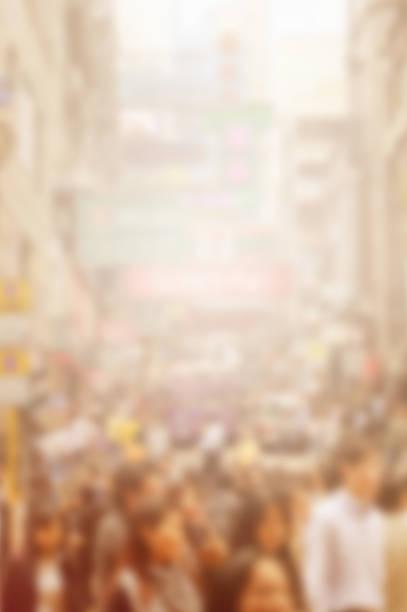 blurred crowded street stock photo