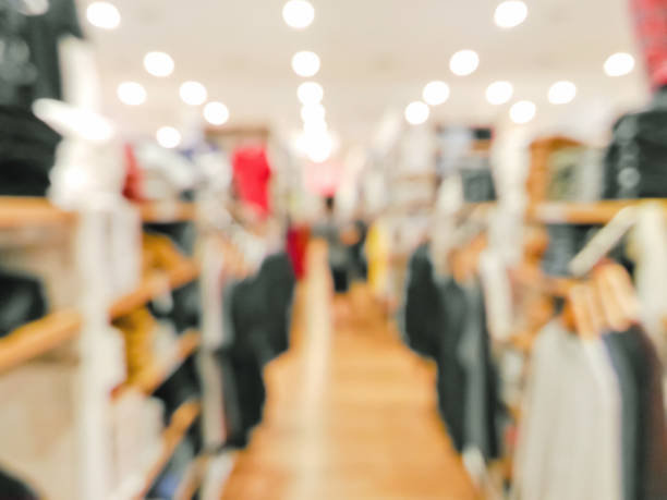 Blurred customer in clothing shop stock photo