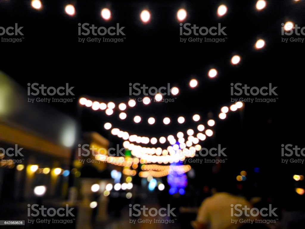 Blurred customers dining at restaurant with bokeh light stock photo