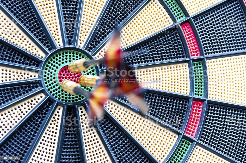 Blurred darts stuck in bulls-eye royalty-free stock photo