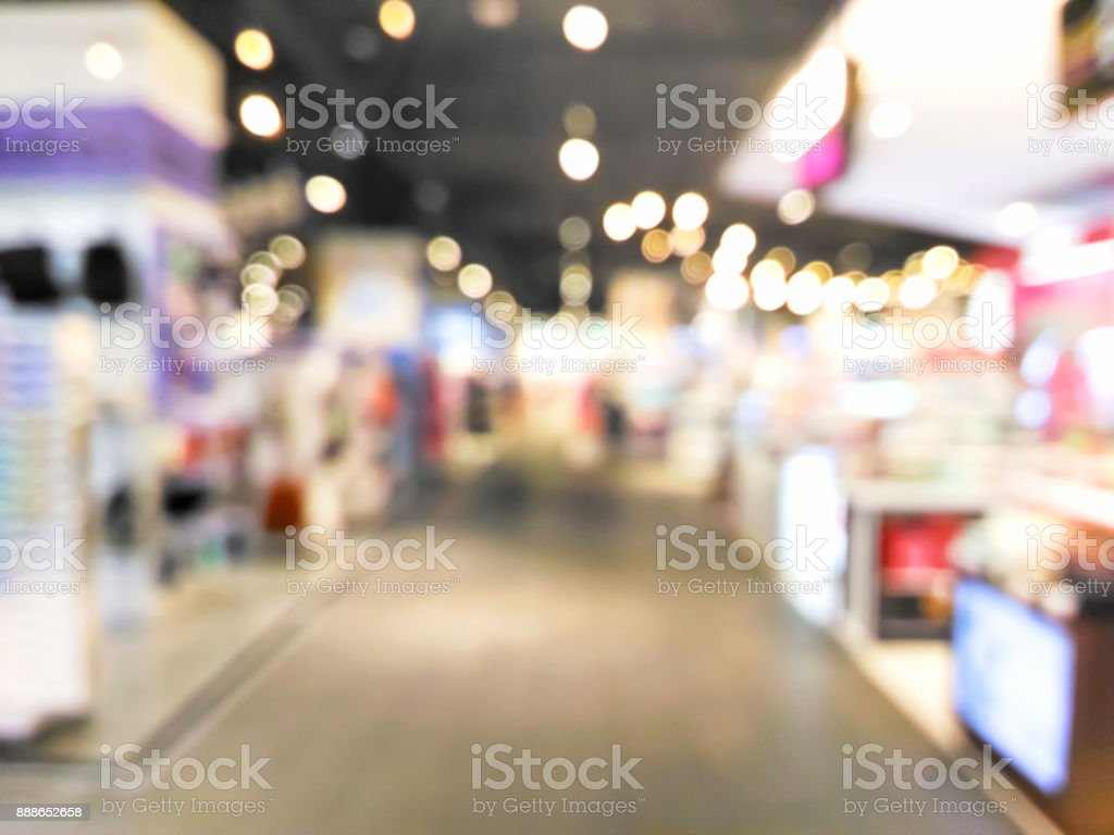 Blurred decorative and colorful shopping mall with bokeh light stock photo