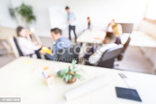 istock Blurred defocused background of business people meeting 618851838