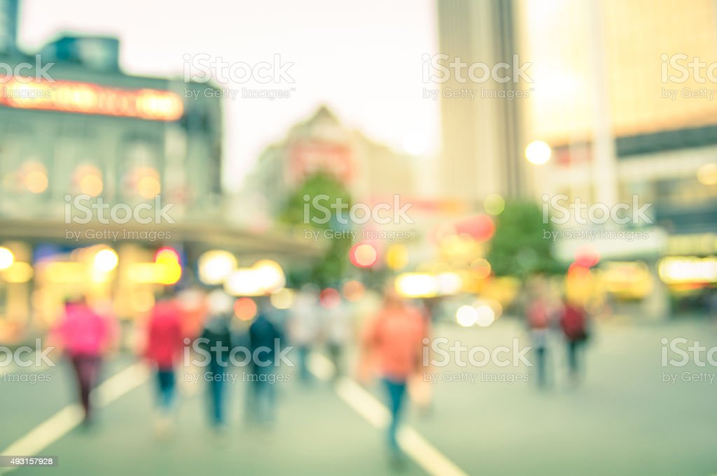Blurred defocused background of people walking on the road stock photo