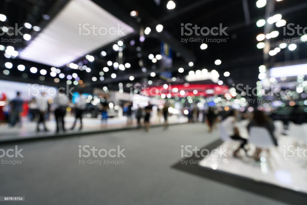 Blurred, defocused background of public event exhibition hall. Business trade show or commercial activity concept stock photo