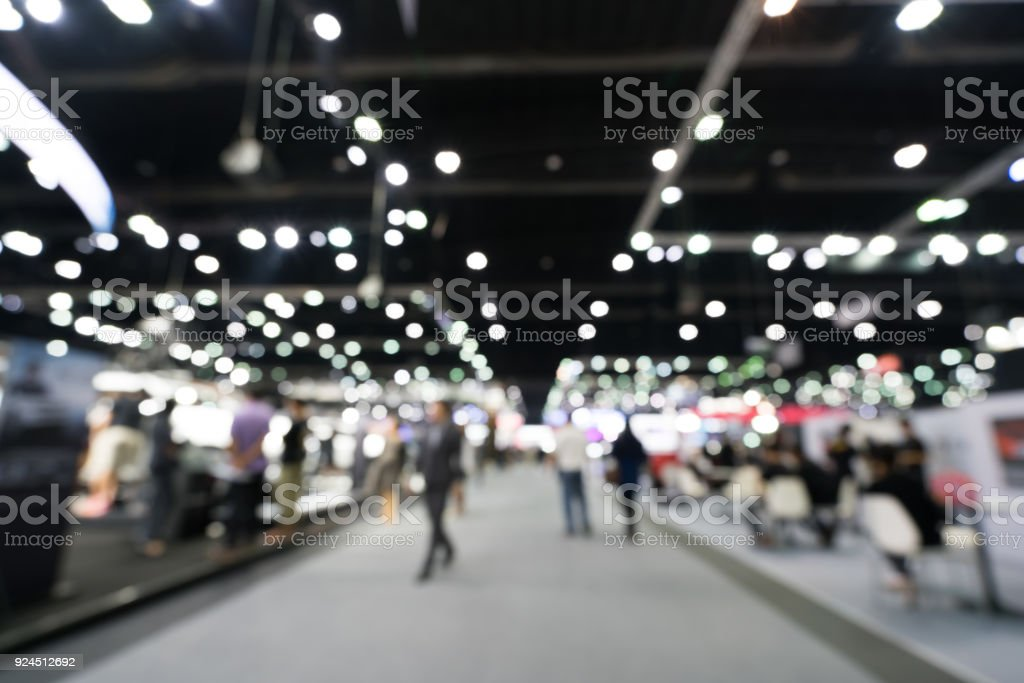 Blurred, defocused background of public exhibition hall. Business tradeshow or stock market, organization or company event, commercial trading fair, or shopping mall marketing advertisement concept stock photo