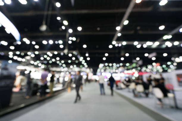 Blurred, defocused background of public exhibition hall. Business tradeshow or stock market, organization or company event, commercial trading fair, or shopping mall marketing advertisement concept Blurred, defocused background of public exhibition hall. Business tradeshow or stock market, organization or company event, commercial trading fair, or shopping mall marketing advertisement concept event stock pictures, royalty-free photos & images