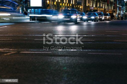 603907998 istock photo blurred defocused lights of night traffic in city 1198952022