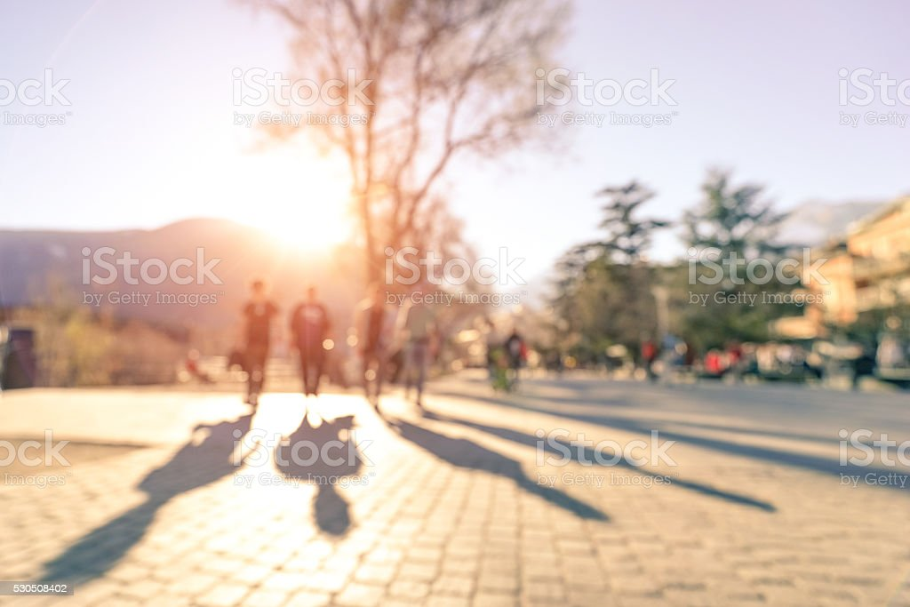 Blurred defocused silhouettes of people - Friends walking in Meran stock photo