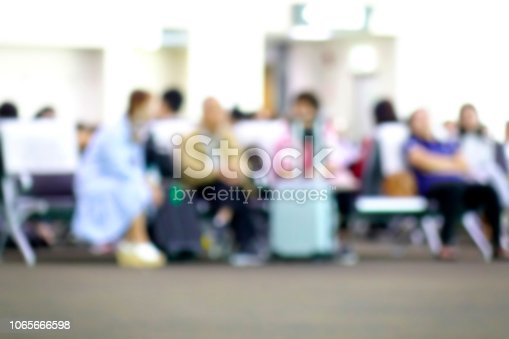 istock Blurred diverse passengers with luggage waiting  at airport boarding. Blurry  travelers sitting. 1065666598