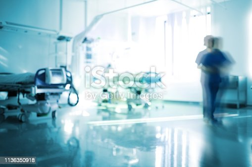 istock Blurred emergency room with walking staff, unfocused background 1136350918