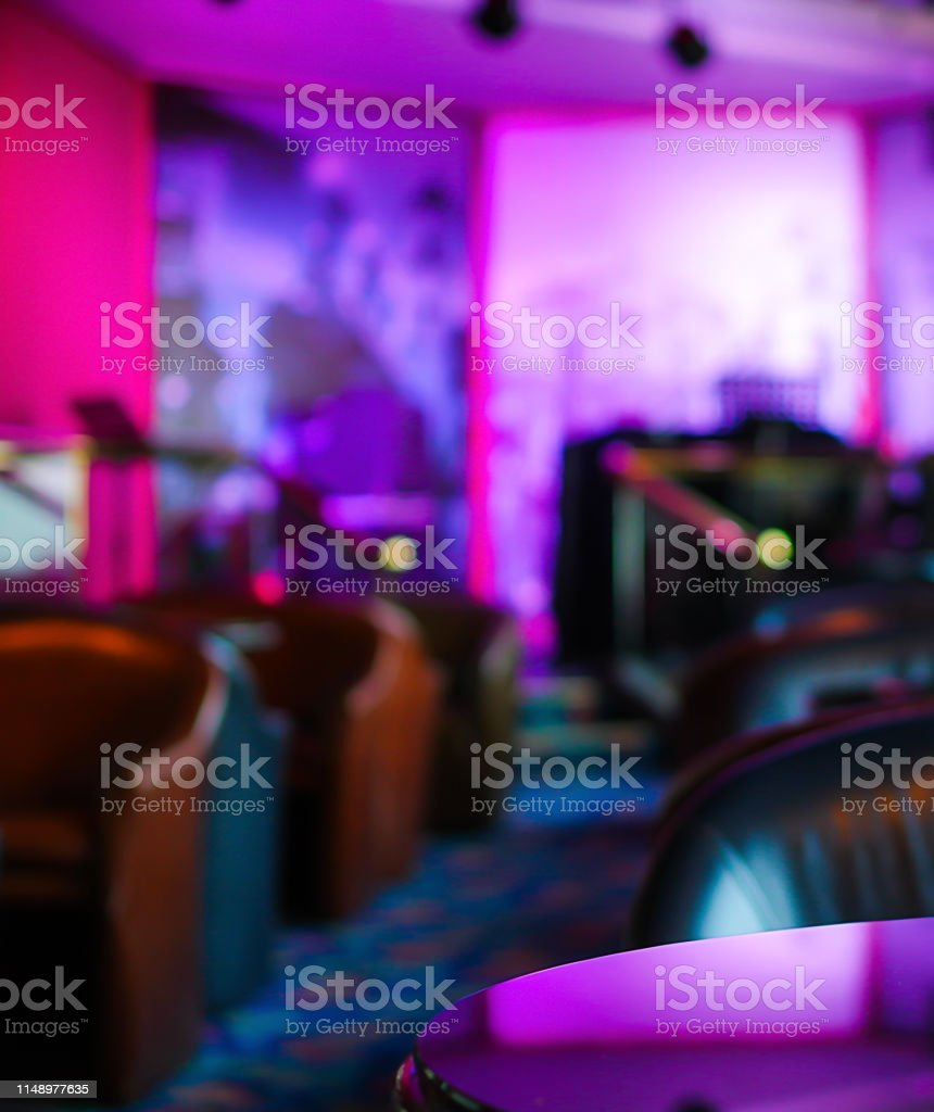 Glass table blurred bar stage background