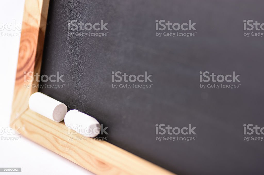 Blurred Empty Mock Up Black Chalkboard with White Chalks. Back to School Concept Education Learning. Creative Image with Copy Space. Poster Banner Template stock photo