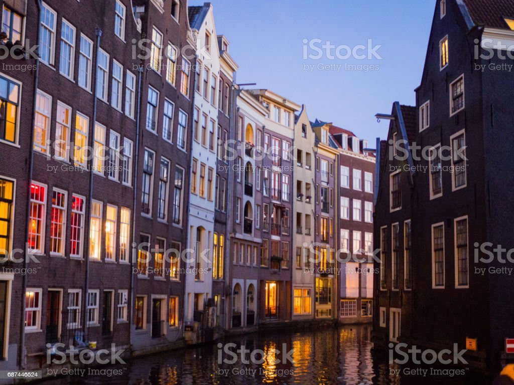Blurred Europe city view, colorful buildings on canal at night stock photo