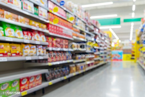 836871040 istock photo Blurred fast food snacks for sale on supermarket shelf. 1170622588