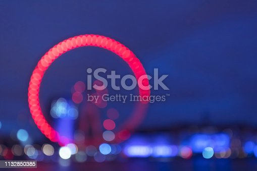 Blurred ferris wheel and bokeh background. City view at night.
