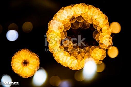 857847778 istock photo Blurred festive yellow and orange Christmas lights 1206775537