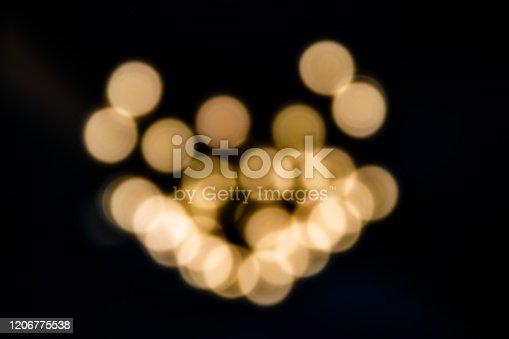 857847778 istock photo Blurred festive yellow and orange Christmas lights 1206775538