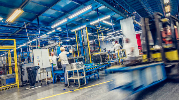blurred forklift and factory workers - manufacturing stock pictures, royalty-free photos & images