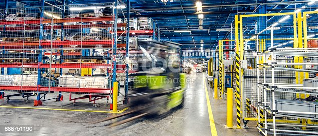 istock Blurred forklift in factory 868751190