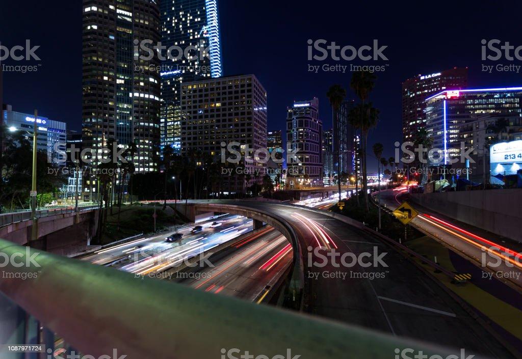 Blurred Freeway Traffic at Night in DTLA stock photo