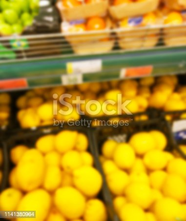 823709528 istock photo Blurred fresh fruits and vegetables at retail store. Abstract background of supermarket. Grocery market blurred background. Fruits in store racks. Interior shopping mall defocused background 1141380964