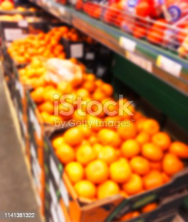 823709528 istock photo Blurred fresh fruits and vegetables at retail store. Abstract background of supermarket. Grocery market blurred background. Fruits in store racks. Interior shopping mall defocused background 1141381322