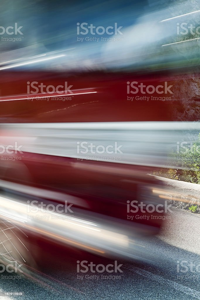 Blurred Front View of Truck Speeding Down Road royalty-free stock photo
