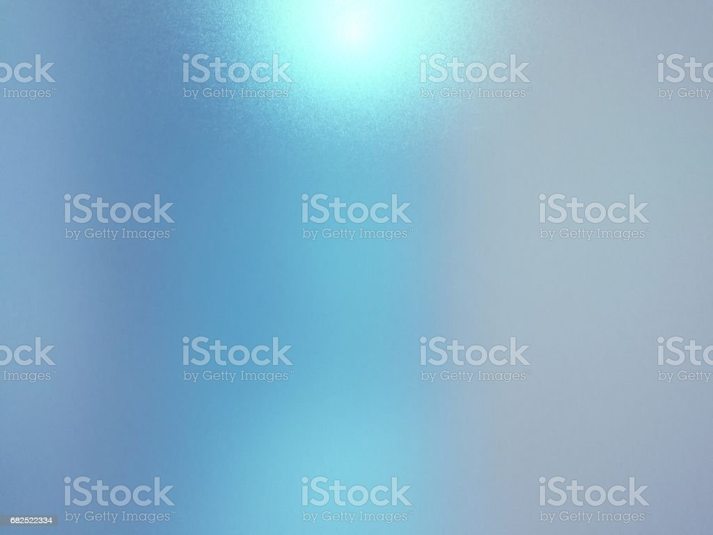 Blurred frosted glass texture background with light reflection, Grey and blue colors. stock photo