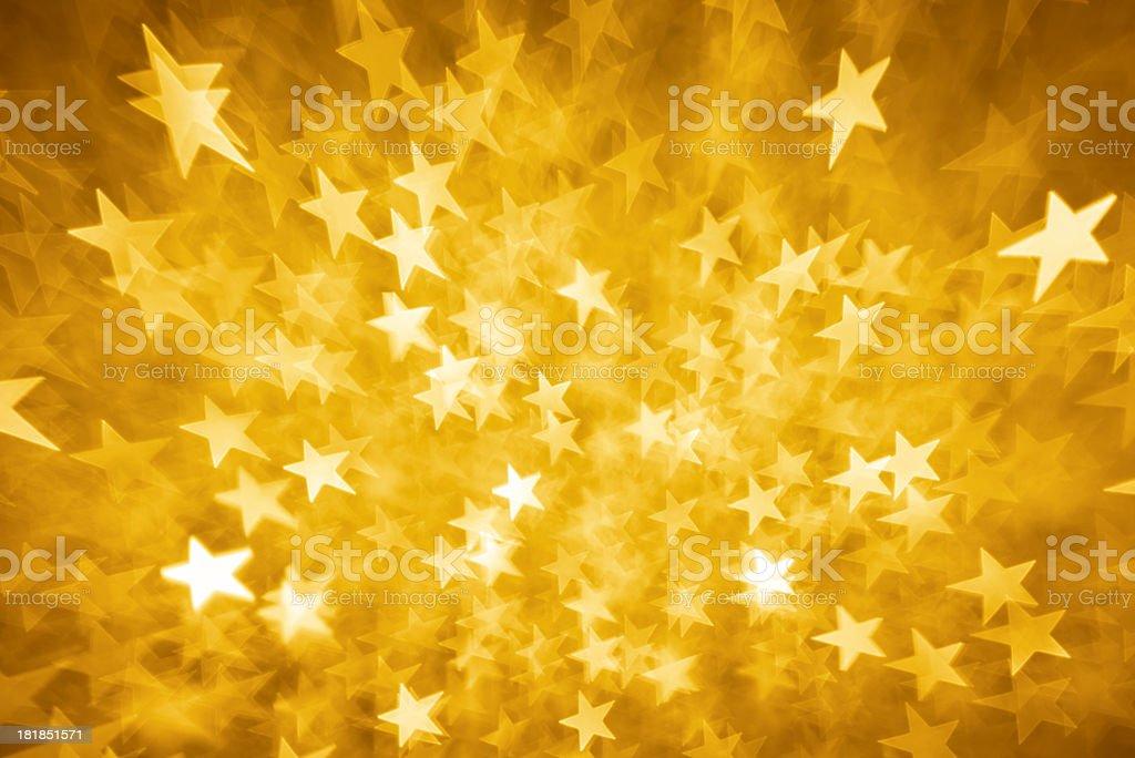 Offuscata oro luci a forma di stella fotografie stock e altre