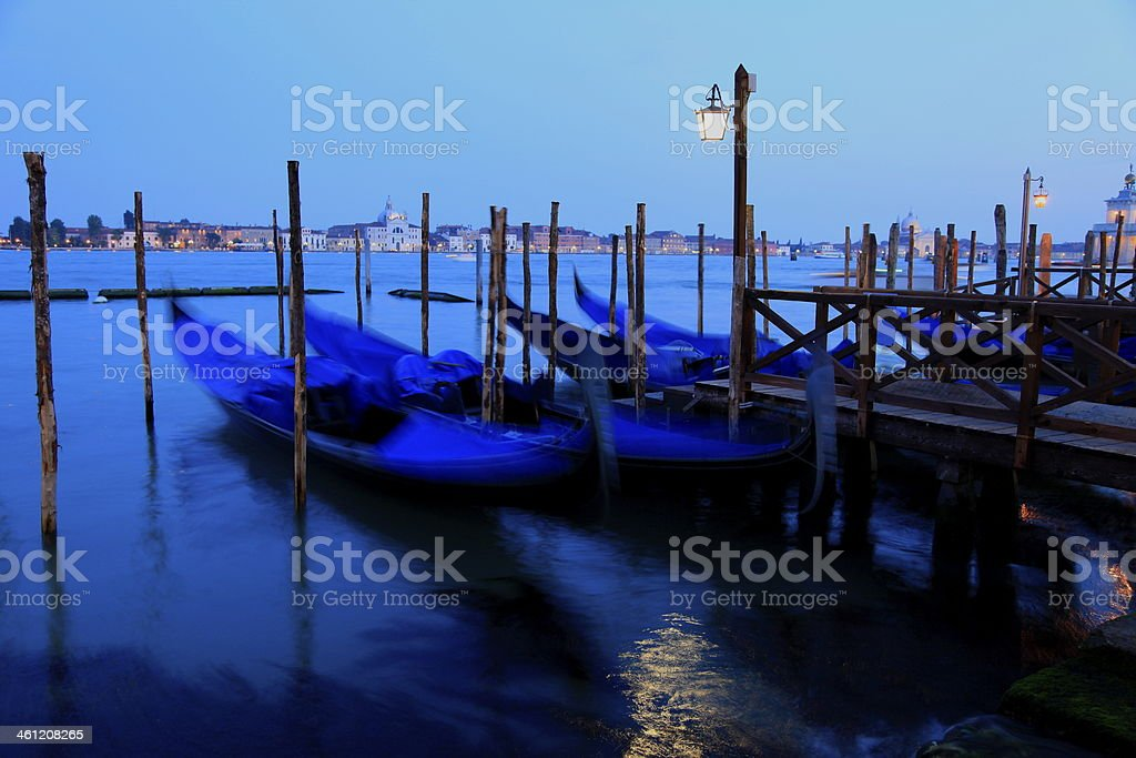 Blurred Gondolas pier and Venice at blue night, Italy royalty-free stock photo