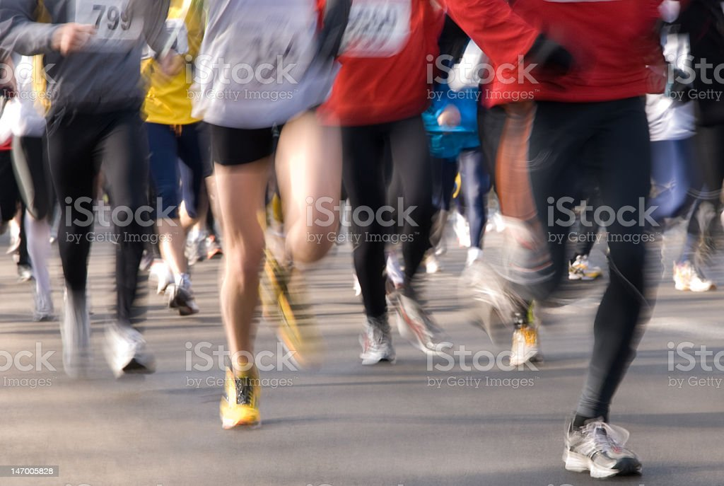 Blurred group of marathon runners during a race royalty-free stock photo