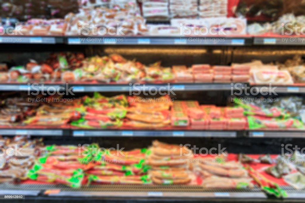 blurred ham sausage background in the supermarket stock photo