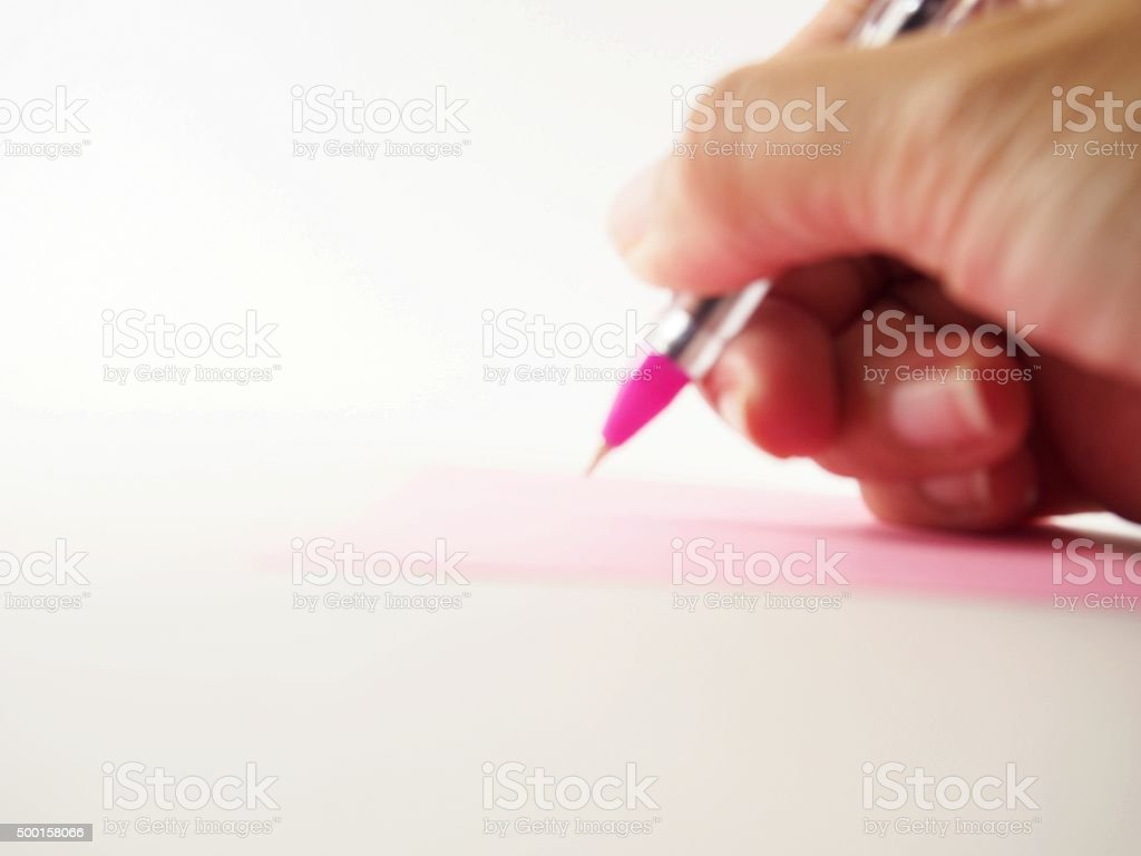 Blurred hand, signing, writing on paper, out of focus stock photo