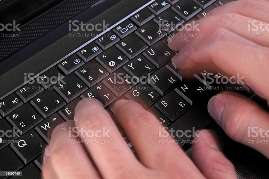 blurred hands typing royalty-free stock photo