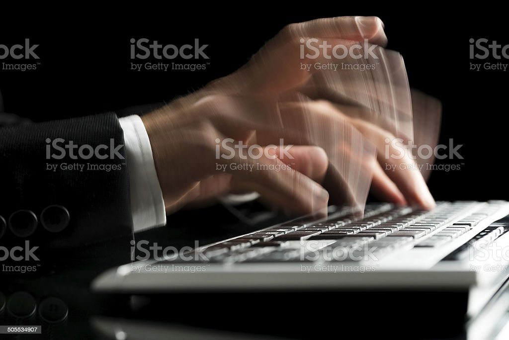 Blurred hands typing stock photo