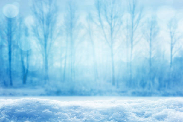 blurred icy winter landscape - snowflake background stock pictures, royalty-free photos & images