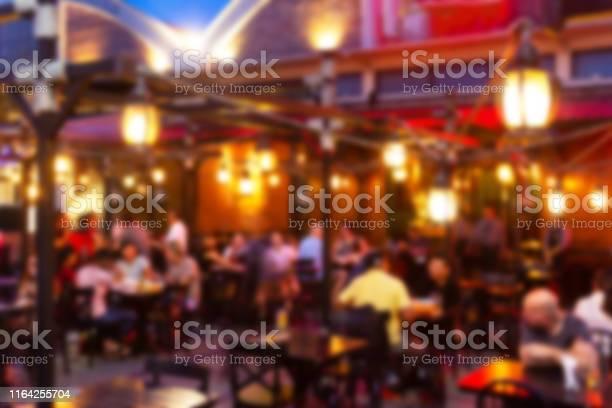 Blurred image lots of people enjoy at the bar pub fun of night in a picture id1164255704?b=1&k=6&m=1164255704&s=612x612&h=9amby03s bqfqmrxxxmswazqjn0leqptqm1fdlqbhzc=
