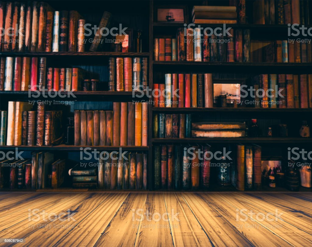 blurred Image many old books on bookshelf in library stock photo
