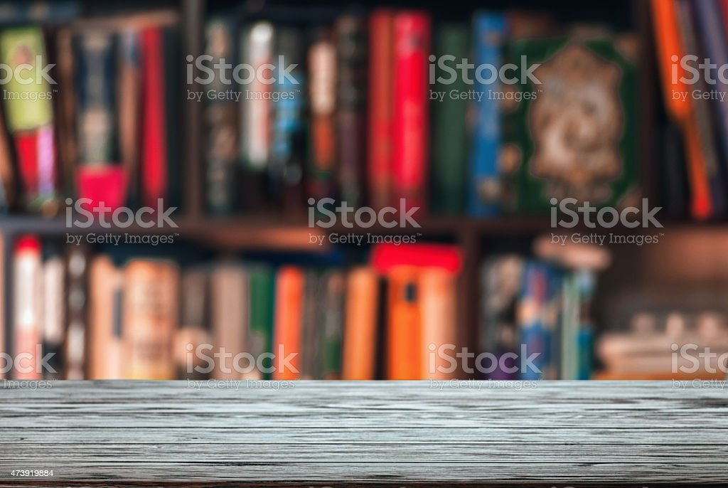 A blurred image of a large bookshelf stock photo